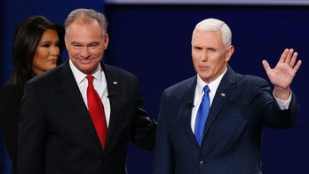 Republican vice-presidential nominee Gov. Mike Pence, right, and Democratic vice-presidential nominee Sen. Tim Kaine stand before the audience during the vice-presidential debate at Longwood University in Farmville, Va., Tuesday, Oct. 4, 2016. (AP Photo/Steve Helber)
