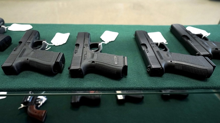 FILE -- December 7, 2015: A selection of Glock pistols are seen for sale at the Pony Express Firearms shop in Parker, Colorado.