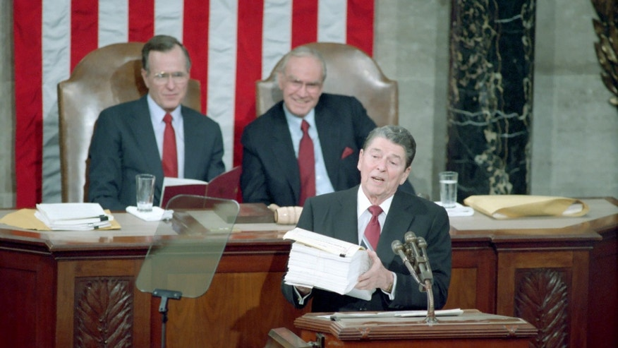 January 25, 1988: President Reagan gives the State of the Union Address to Congress with George Bush and Jim Wright seated