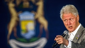 Former President Bill Clinton speaks, Monday, Oct. 3, 2016 at Northbank Center in downtown Flint, Mich. Clinton is campaigning for his wife, 2016 Democratic presidential nominee Hillary Clinton, in Michigan. (Jake May/The Flint Journal via AP)