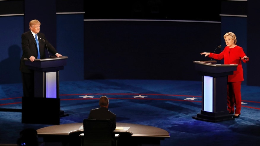 Democratic presidential nominee Hillary Clinton gestures as she appears on stage with Republican presidential nominee Donald Trump during the presidential debate at Hofstra University in Hempstead, N.Y., Monday, Sept. 26, 2016.