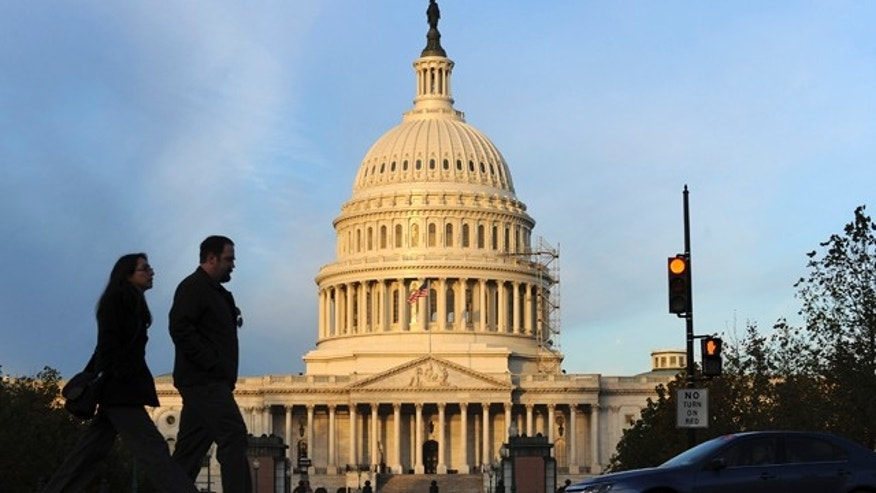 People walk past the U.S. Capitol.