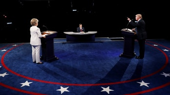 LAS VEGAS, NV - OCTOBER 19:  Republican presidential nominee Donald Trump (R) speaks as Democratic presidential nominee former Secretary of State Hillary Clinton looks on during the third U.S. presidential debate at the Thomas & Mack Center on October 19, 2016 in Las Vegas, Nevada. Tonight is the final debate ahead of Election Day on November 8.  (Photo by Joe Raedle/Getty Images)