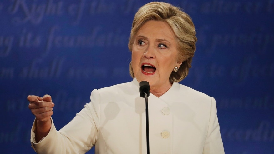 Democratic presidential nominee Hillary Clinton speaks to Republican presidential nominee Donald Trump during the third presidential debate at UNLV in Las Vegas, Wednesday, Oct. 19, 2016. (AP Photo/Patrick Semansky)
