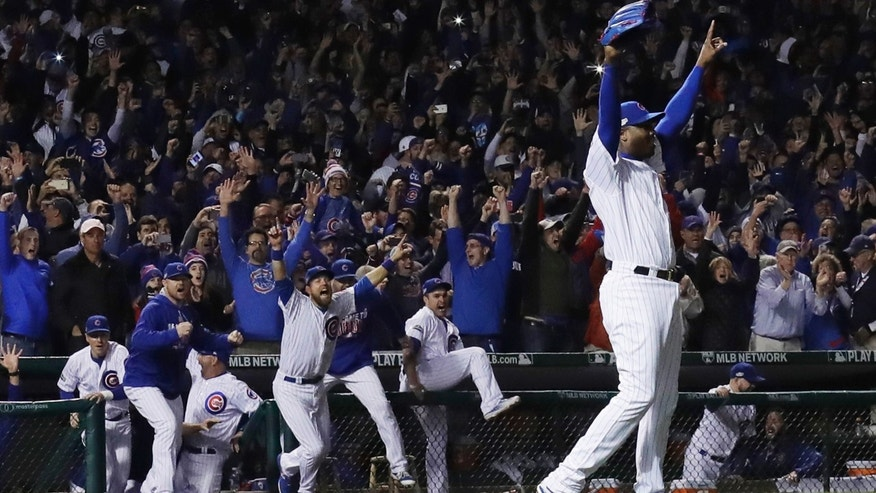 Chicago Cubs relief pitcher Aroldis Chapman (54) celebrates after Game 6 of the National League baseball championship series against the Los Angeles Dodgers, Saturday, Oct. 22, 2016, in Chicago. The Cubs won 5-0 to win the series and advance to the World Series against the Cleveland Indians.
