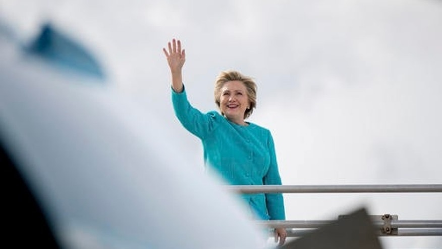 Oct. 26, 2016: Democratic presidential candidate Hillary Clinton waves before boarding her campaign plane at Miami International Airport in Miami.