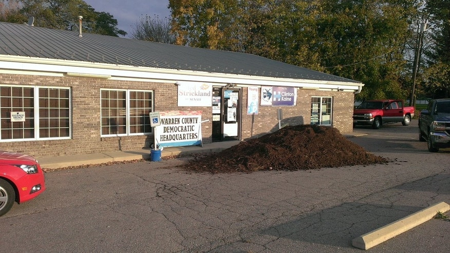 A giant pile of manure was dumped outside the Warren County Democratic headquarters.