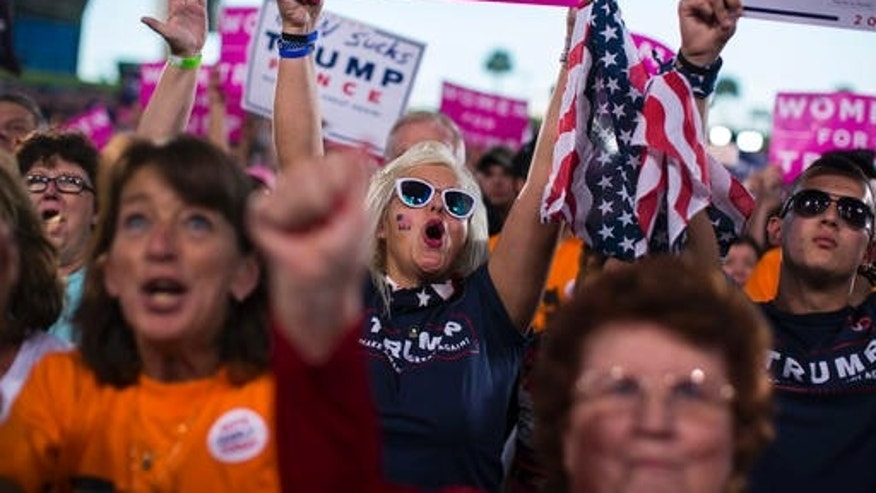 Supporters of Republican presidential candidate Donald Trump cheer during a campaign rally, Monday, Oct. 24, 2016, in Tampa, Fla.