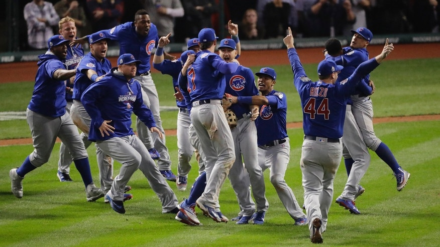 Chicago Cubs celebrate after Game 7 of the Major League Baseball World Series against the Cleveland Indians Thursday, Nov. 3, 2016, in Cleveland.