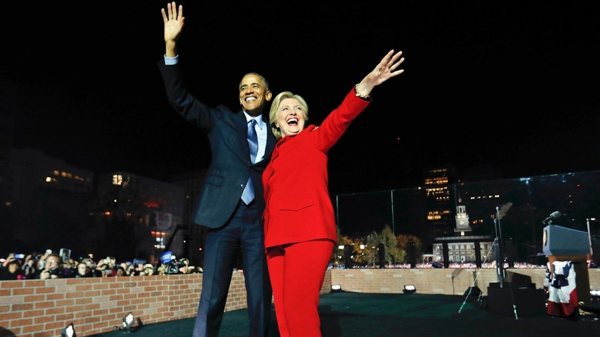President Barack Obama waves on stage with Democratic presidential candidate Hillary Clinton during a rally at Independence Hall in Philadelphia, Monday, Nov. 7, 2016.
