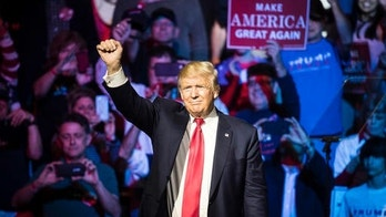 Republican presidential candidate Donald Trump waves to the crowd during a campaign rally, Thursday, Oct. 13, 2016, in Cincinnati. (AP Photo/John Minchillo)