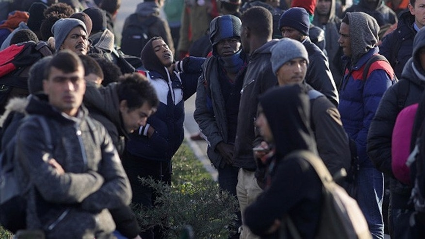 CALAIS, FRANCE - OCTOBER 27:  Migrants wait outside the closed official relocation centre and ponder their next move on October 27, 2016 in Calais, France. Authorities have now declared the site empty of migrants although aid workers say that up to 100 minors are still living there. The french government say 5,600 people have been moved to reception centres across France since Monday.  (Photo by Christopher Furlong/Getty Images)