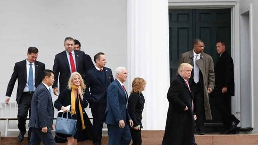 President-elect Donald Trump, foreground from right, Charlotte Pence, Vice President-elect Mike Pence, incoming White House Chief of Staff Reince Priebus and Kellyanne Conway leave services at Lamington Presbyterian Church in Bedminster, N.J., Sunday, Nov. 20, 2016. (AP Photo/Carolyn Kaster)