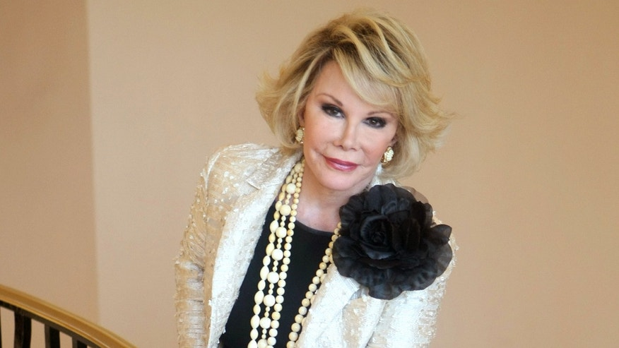 "FILE - Oct. 5, 2009. Joan Rivers posing as she presents ""Comedy Roast with Joan Rivers "" in Cannes."