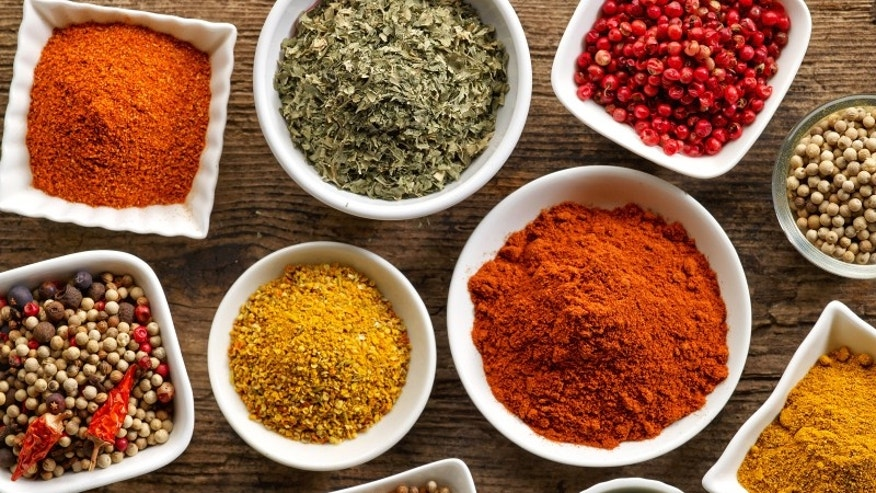 Various spices on a wooden table.