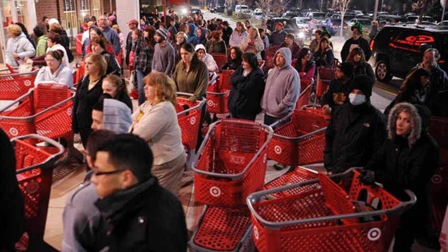 FILE - Nov. 25, 2011: A crowd of shoppers wait outside the Target store in Lisbon, Conn., before the store opens for Black Friday shopping at midnight.