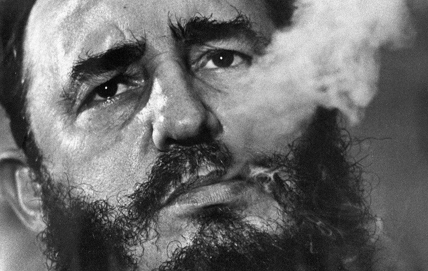 FILE - In this March 1985 file photo, Cuba's leader Fidel Castro exhales cigar smoke during an interview at the presidential palace in Havana, Cuba. Castro has died at age 90. President Raul Castro said on state television that his older brother died late Friday, Nov. 25, 2016. (AP Photo/Charles Tasnadi, File)