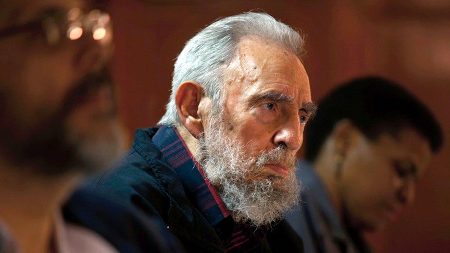 FILE -- Fidel Castro meets with intellectuals and writers at the International Book Fair in Havana, Cuba, on Feb. 10, 2012.