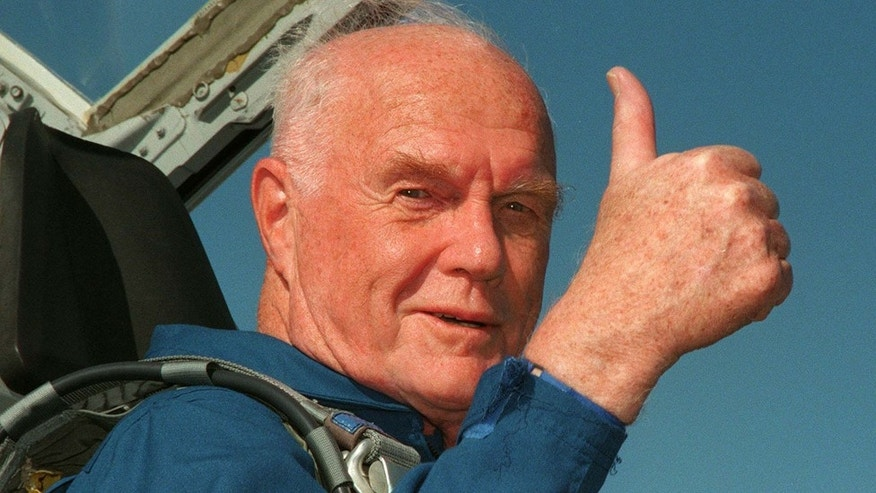 Ohio Senator John Glenn gives the thumbs up sign from the cockpit of his T-38 jet aircraft as he arrives at the Kennedy Space Centre October 26. Glenn, 77, blasted off aboard the shuttle Discovery on October 29, becoming the oldest person ever to go into space.