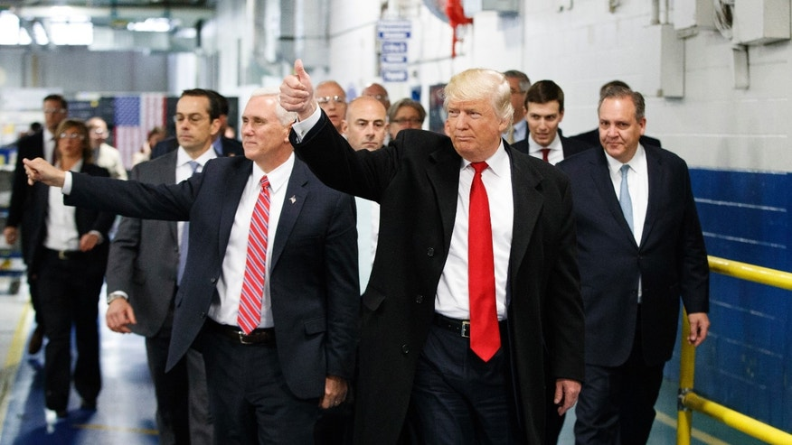 FILE - In this Thursday, Dec. 1, 2016 file photo, President-elect Donald Trump and Vice President-elect Mike Pence wave as they visit to Carrier factory, in Indianapolis, Ind.