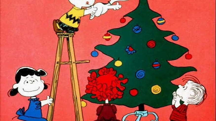 "Lucy, Charlie Brown, Snoopy and Linus in scene from tv special ""A Charlie Brown Christmas."""