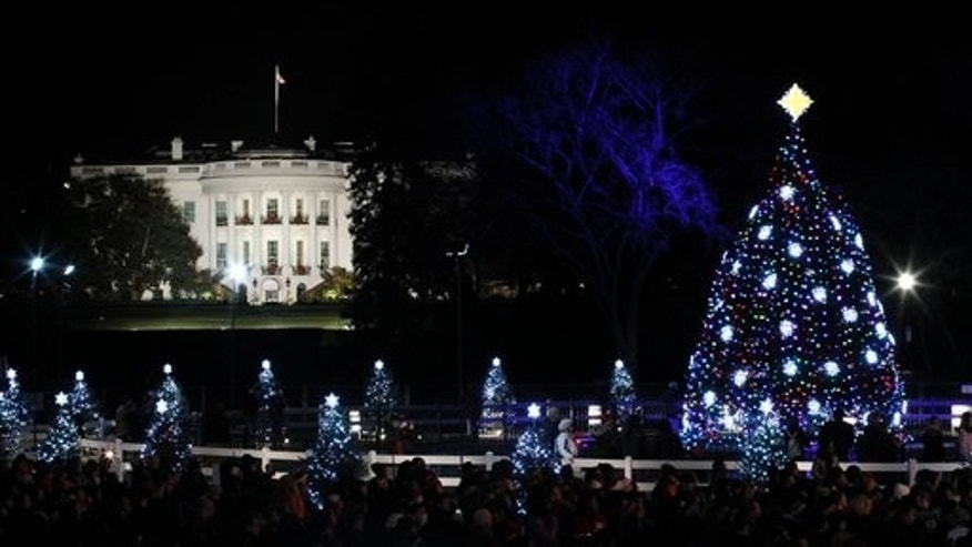 FILE -- The National Christmas Tree is pictured with the White House in the background after it was lit on the Ellipse across from the White House in Washington, Thursday, Dec., 1, 2011.