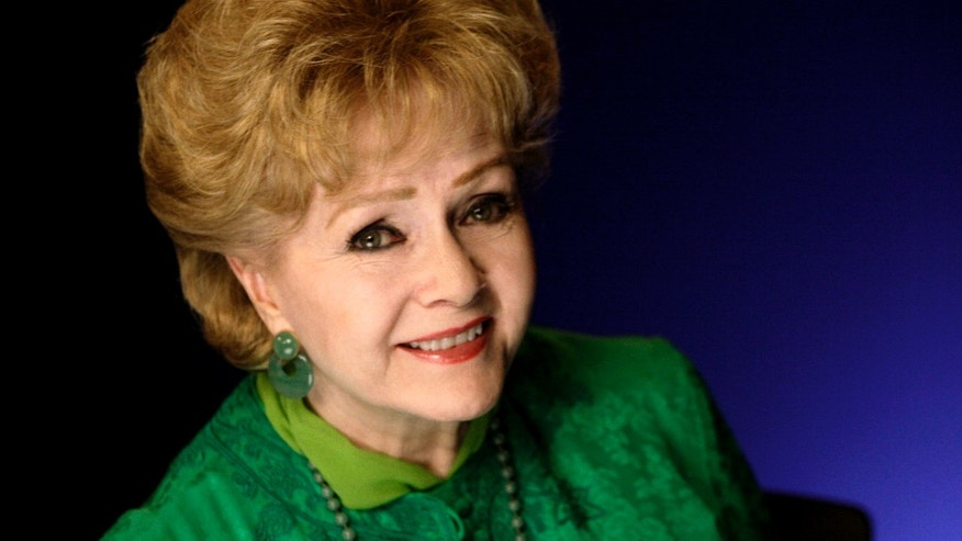 FILE - This Oct. 14, 2011 file photo shows actress Debbie Reynolds posing for a portrait in New York.