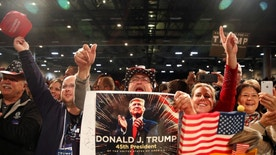 Supporters of U.S. President-elect Donald Trump cheer at the USA Thank You Tour event at the Iowa Events Center in Des Moines, Iowa, U.S., December 8, 2016. REUTERS/Shannon Stapleton - RTSVBN0