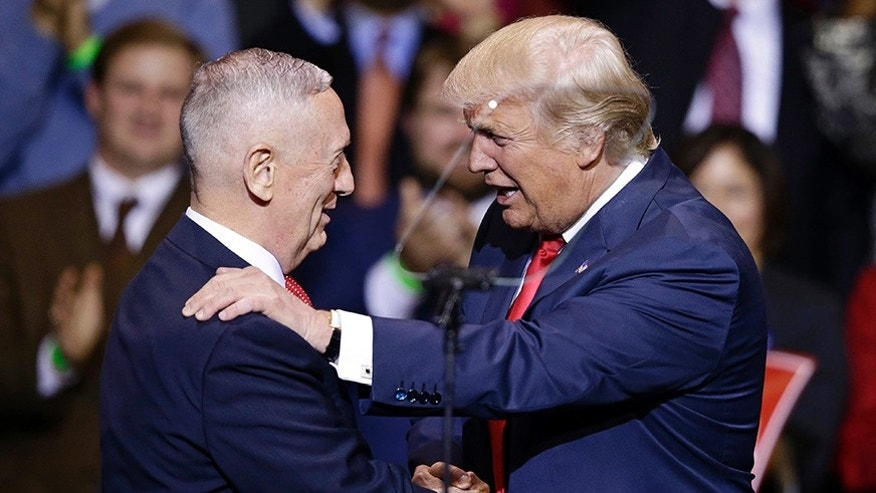 In this Dec. 6, 2016, photo, President-elect Donald Trump introduces retired Marine Corps Gen. James Mattis as his nominee for Secretary of Defense while speaking to supporters during a rally in Fayetteville, N.C.