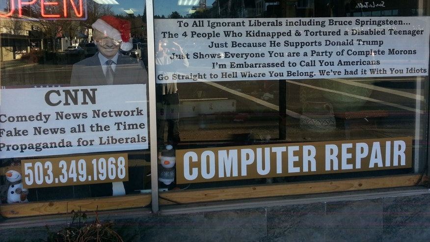 He put this giant sign in the window of his store in Lake Oswego, Oregon.