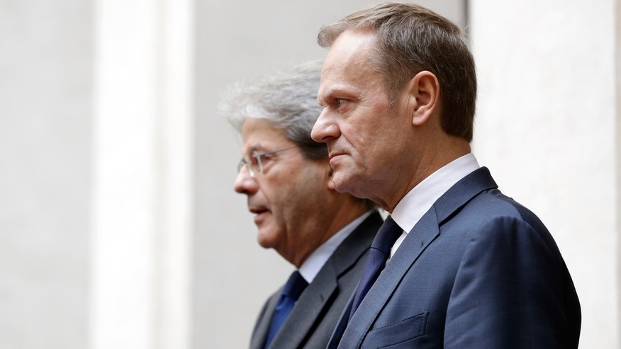 Feb. 1, 2017: Italian Premier Paolo Gentiloni, left, and European Council President Donald Tusk review the honor guard at Chigi Palace's Premier office in Rome.