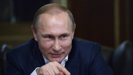 In this photo taken Tuesday, Jan. 5, 2016, Russian President Vladimir Putin speaks during an interview with the German daily Bild at the Russian Black Sea resort of Sochi, Russia. Putin said on Tuesday, Jan. 12 that it would be too early to speak about granting political asylum to Syrian President Bashar Assad, a Putin ally and arguably the main obstacle in the Syrian peace process. (Alexei Nikolsky/Sputnik, Kremlin Pool Photo via AP)