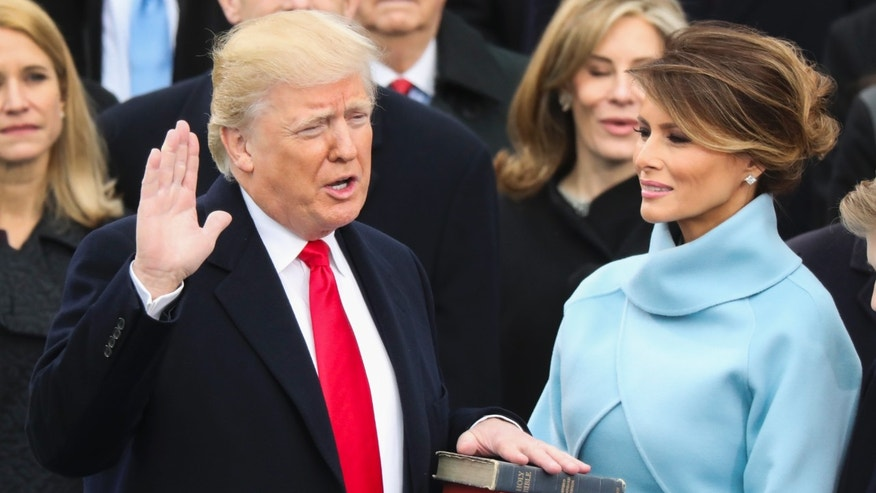 FILE -- Jan. 20, 2017: Donald Trump is sworn in as the 45th president of the United States as Melania Trump looks on during the 58th Presidential Inauguration at the U.S. Capitol in Washington.