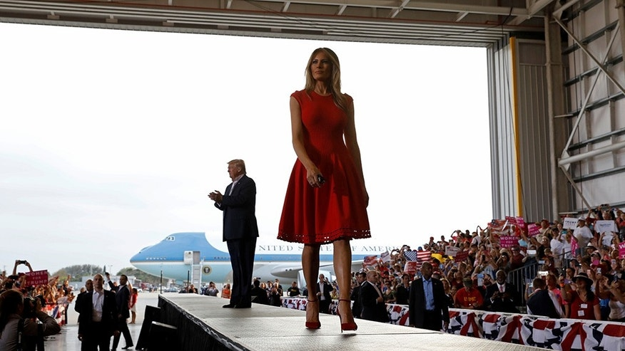 "U.S. President Donald Trump and first lady Melania Trump arrive at a ""Make America Great Again"" rally at Orlando-Melbourne International Airport in Melbourne, Florida, U.S. February 18, 2017."