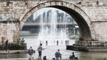 Anglers fish near a fountain in the Vardar River, in downtown Skopje, Macedonia, Sunday, Sept. 14, 2014. Many people in Skopje prefer urban fishing in the central river during weekends rather than heading for the country. (AP Photo/Boris Grdanoski)