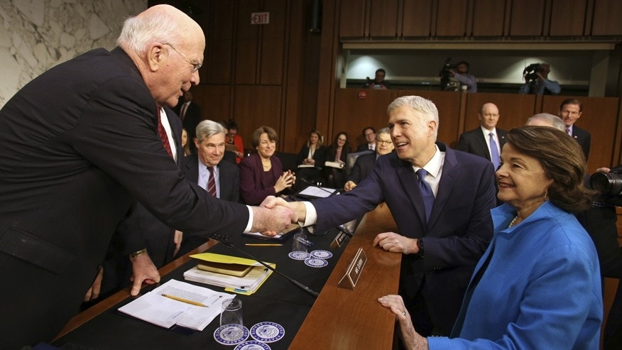 FILE -- Judge Neil Gorsuch meets with Sens. Leahy and Feinstein.