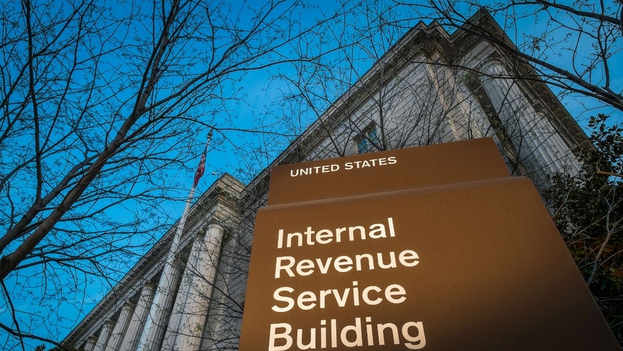 FILE -This April 13, 2014 file photo shows the headquarters of the Internal Revenue Service (IRS) in Washington. Tuesday, April 15, is the federal tax filing deadline for most Americans. (AP Photo/J. David Ake, File)