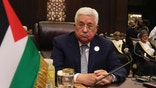 FILE -- In this March 29, 2017 file photo, Palestinian President Mahmoud Abbas attends theArab League summit, at the Dead Sea, Jordan. Abbas' initial relief over having been invited to the White House is now clouded by concerns that he will have to say no to President Donald Trump in their first meeting Wednesday, May 3, 2017. A key worry is that Trump will ask Abbas to halt monthly stipends for thousands of Palestinian security prisoners held by Israel, a seemingly untenable step at a time when a mass hunger strike has led to an outpouring of Palestinian popular support for the inmates. (AP Photo/ Raad Adayleh, File)