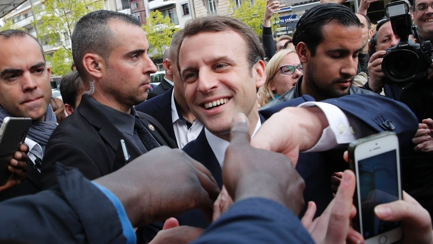 FILE -- May 5, 2017: French independent centrist presidential candidate Emmanuel Macron shakes hands to supporters as he campaigns in Rodez, southern France.