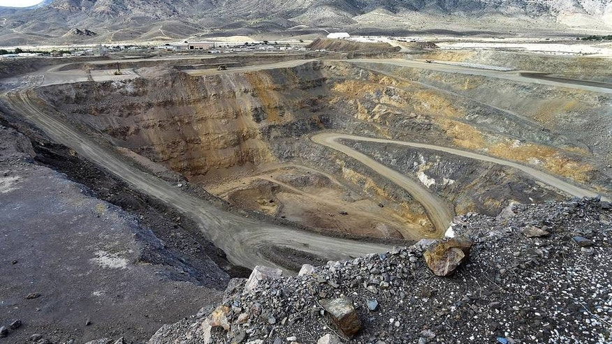 FILE -- An open pit mine at Molycorp's rare-earths facility in Mountain Pass, Calif.