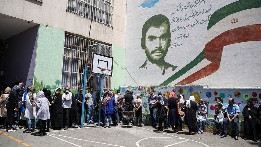 Voters stand in a queue to cast their ballots during the presidential election in a Jewish and Christian district in the center of Tehran, Iran, May 19, 2017.