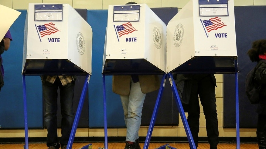 FILE -- Americans vote at a polling station on election day in Harlem, New York, U.S., November 8, 2016.