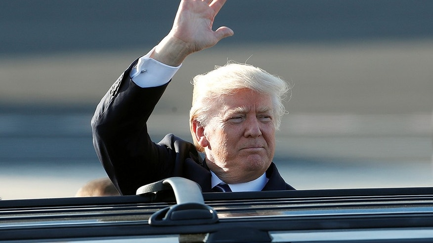 President Donald Trump waves as he arrives at the Leonardo da Vinci-Fiumicino Airport in Rome, Italy, May 23, 2017.