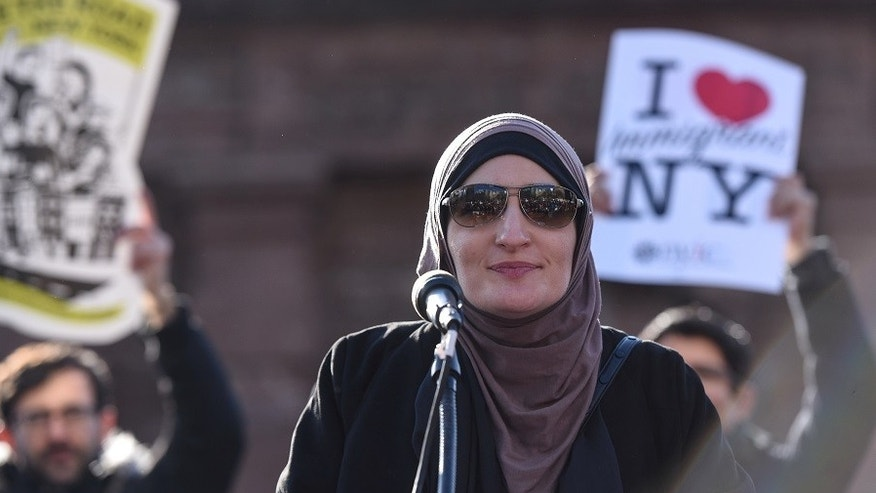 FILE -- Activist Linda Sarsour addresses the crowd during a protest against President Donald Trump's travel ban, in New York City, U.S. January 29, 2017.