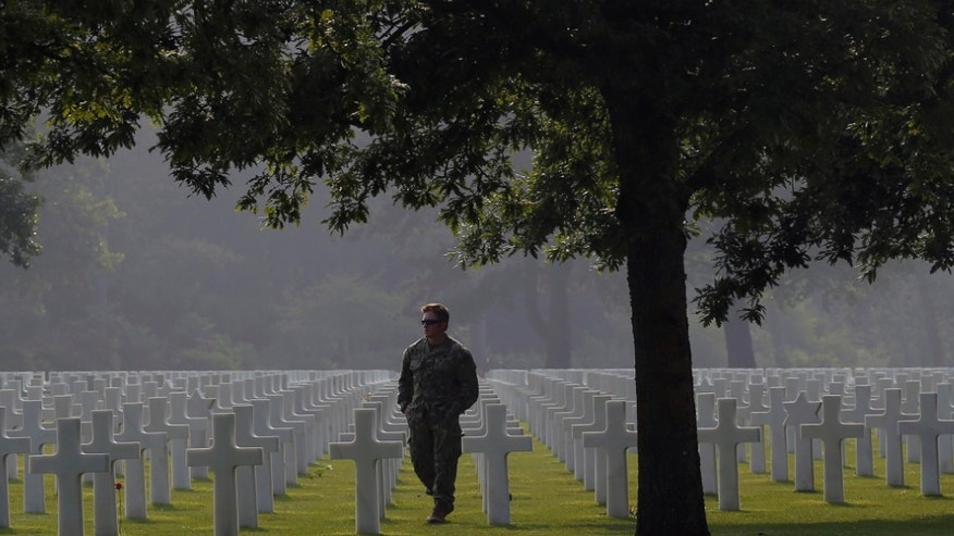 An American soldier, no name given, walks in the Colleville American military cemetery, in Colleville sur Mer, western France, Sunday June 5, 2016, on the eve of the 72nd anniversary of the D-Day landing.