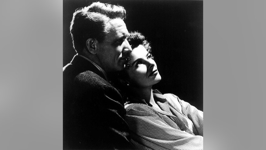 "Actress Katharine Hepburn is shown with actor Spencer Tracy in a 1945 photo from the film ""Without Love."""