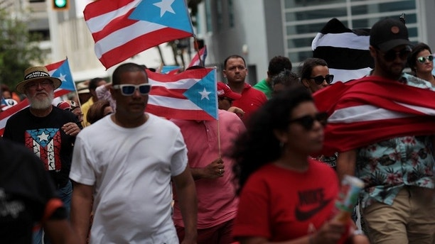 People march in support of Puerto Rico becoming an independent nation as the economically struggling U.S. island territory voted overwhelmingly on Sunday in favour of becoming the 51st state, in San Juan, Puerto Rico June 11, 2017.  REUTERS/Alvin Baez - RTS16MR0