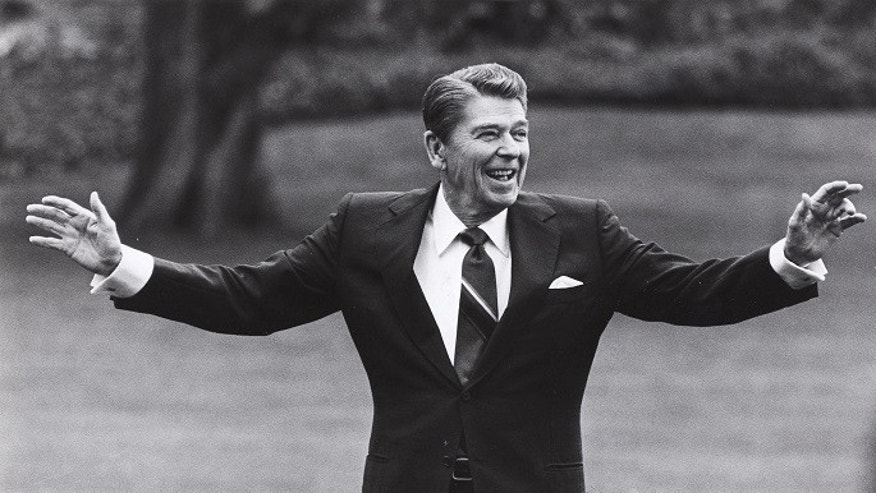 FILE -- Reagan is pictured waving to well-wishers on the south lawn of the White House on April 25, 1986.
