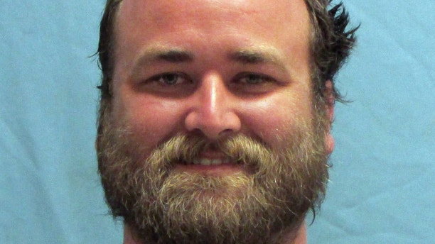 This photo provided by the Pulaski County Sheriff's Office in Little Rock, Ark., shows Michael Tate Reed, of Van Buren, Ark., who was booked into the jail Wednesday morning, June 28, 2017, on preliminary charges of defacing objects of public interest, criminal trespass and first-degree criminal mischief. He is accused driving a vehicle into Arkansas' new Ten Commandments monument on the state Capitol grounds in Little Rock. (Pulaski County Sheriff's Office via AP)