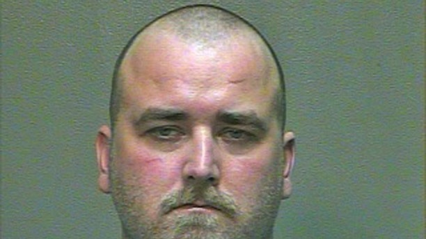 This 2014 booking photo provided by the Oklahoma County Sheriff's Office shows Michael Tate Reed. Reed, of Van Buren, Ark., was admitted to a hospital for mental treatment and formal charges were never filed after he allegedly drove his car into the Ten Commandments monument on the state Capitol grounds in 2014. On Wednesday, June 28, 2017, Reed was arrested for driving into and smashing the monument. (Oklahoma County Sheriff's Office via AP)